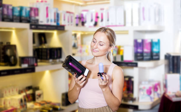 Female customer shopping sex toy Beautiful female customer shopping sex toy in store for adults dildo stock pictures, royalty-free photos & images