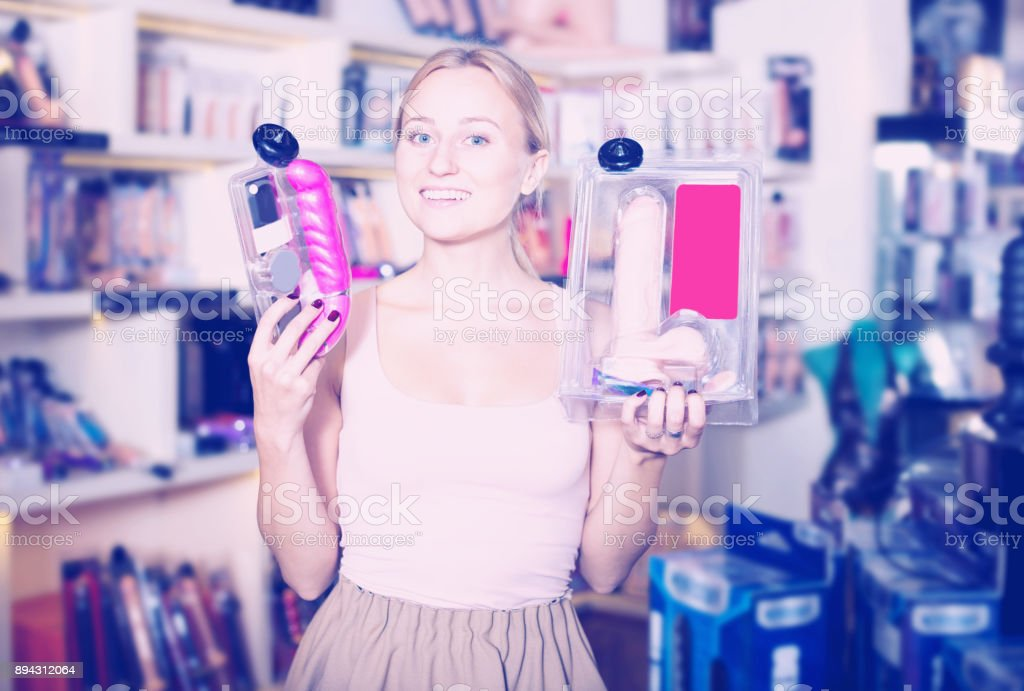 Female customer shopping sex toy stock photo