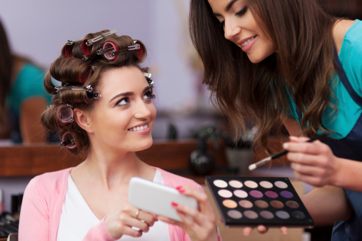 Female customer showing make-up which she wants