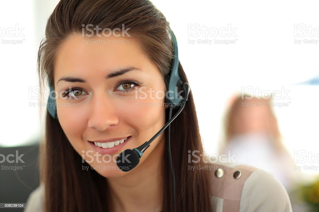 Female customer support operator with headset and smiling stock photo