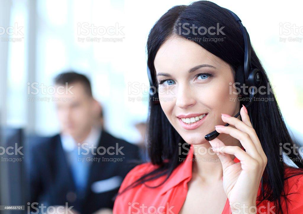 Weibliche Kunden-support-Betreiber mit headset - Lizenzfrei Am Telefon Stock-Foto
