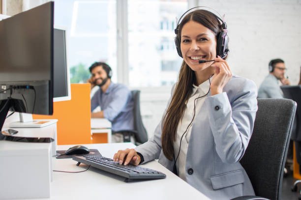 Female customer support operator working in call center. Help and technical support concept. stock photo