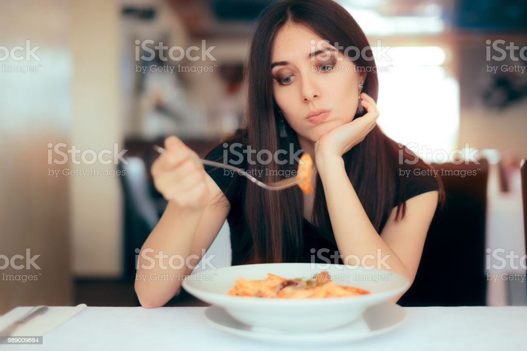 Female Customer Unhappy with the Dish Course in Restaurant - fotografia de stock