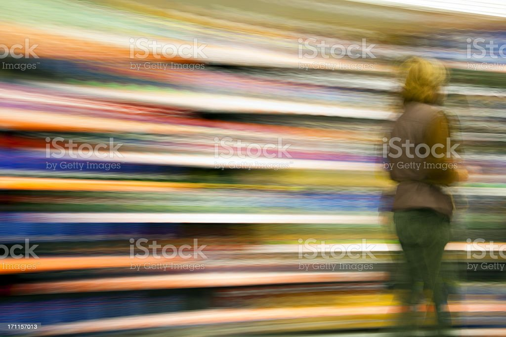 Female Customer Walking Against Colorful Background, Blurred Motion royalty-free stock photo