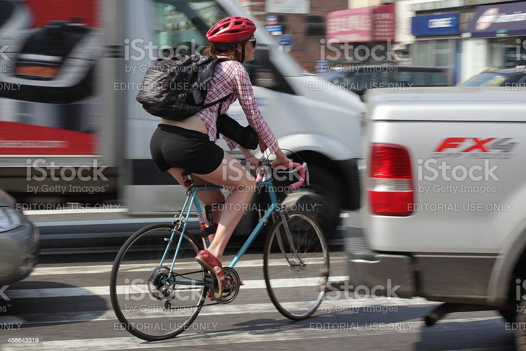 NYC female cycling in rush hour traffic royalty-free stock photo