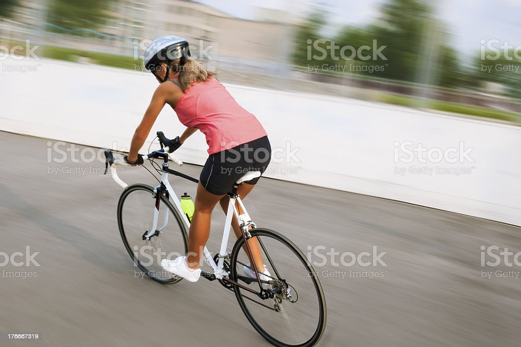 female cyclist making excercise on race bike. image with panning royalty-free stock photo