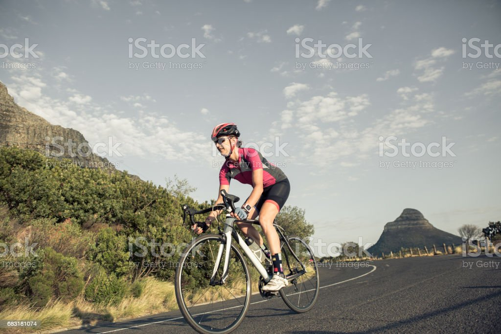 Female cyclist on her road bike stock photo