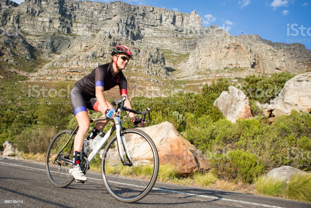 Female cyclist out on a training ride on her road bike stock photo