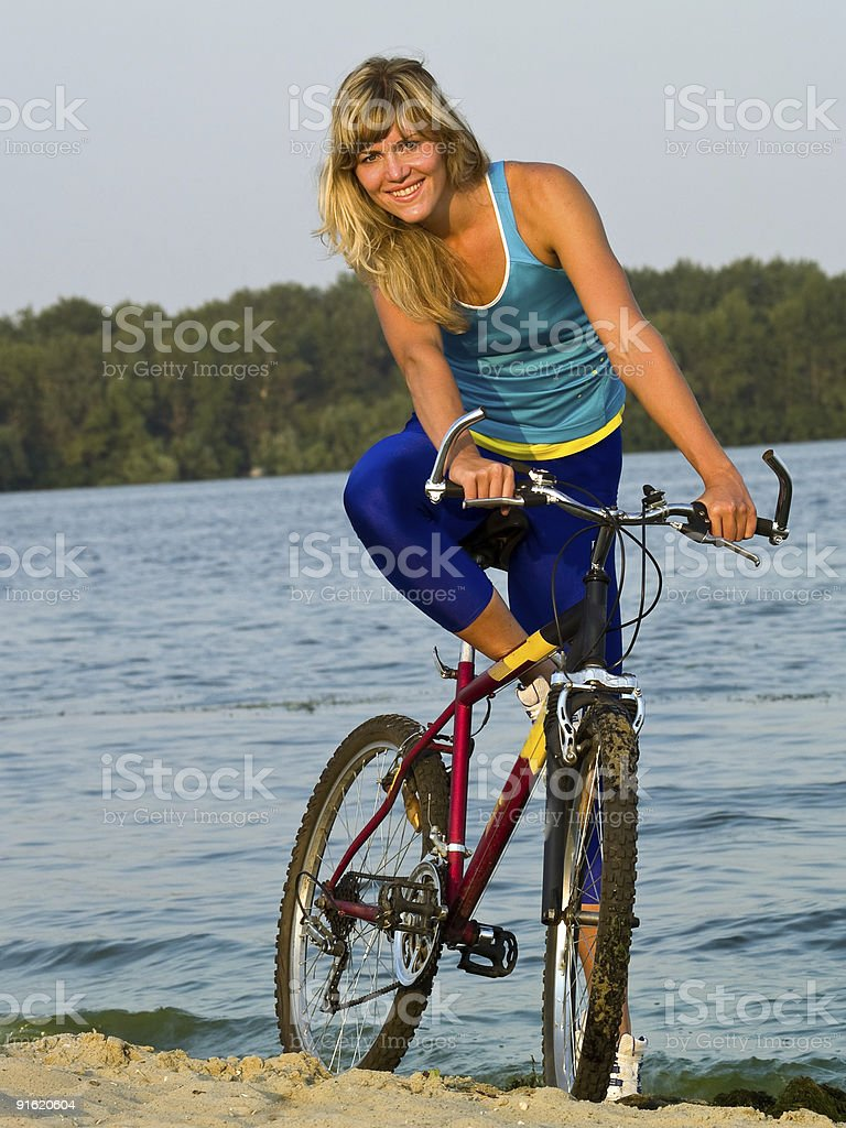Female cyclist posing outdoors royalty-free stock photo
