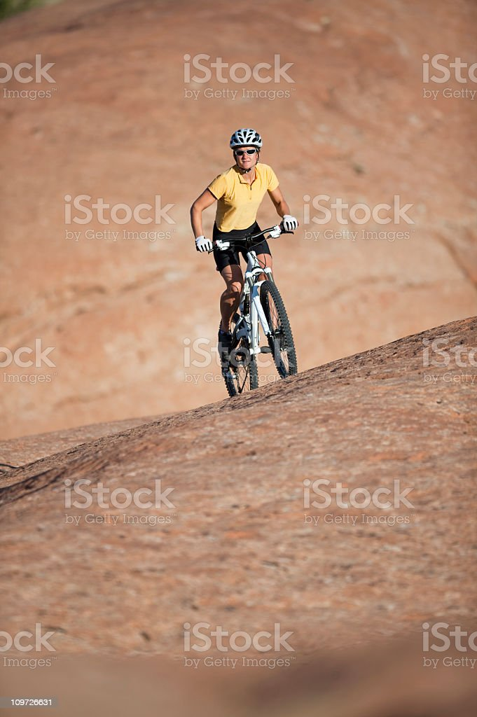 Female Cyclist Riding Bicycle In Moab, Utah royalty-free stock photo
