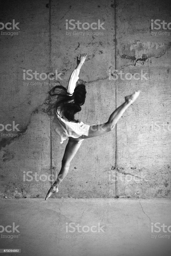 A female dancer in a jump stock photo