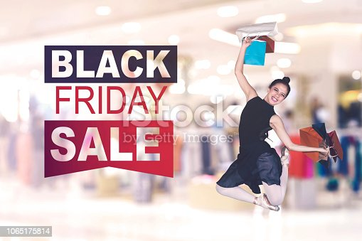 istock Female dancer jumps with Black Friday Sale text 1065175814