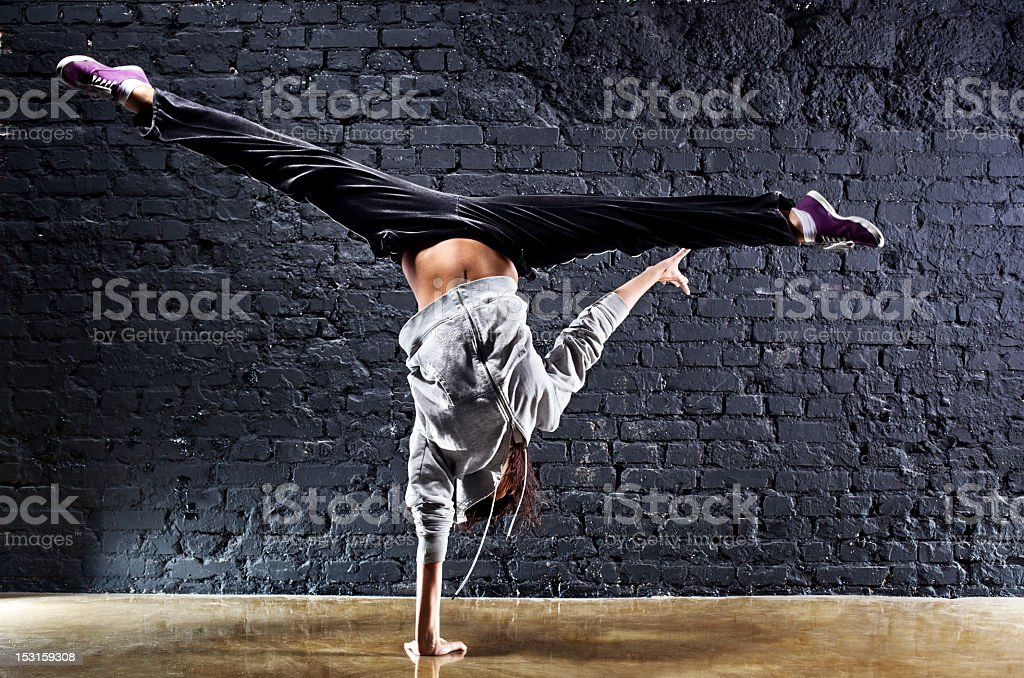 Female dancer showing off a handstand trick stock photo