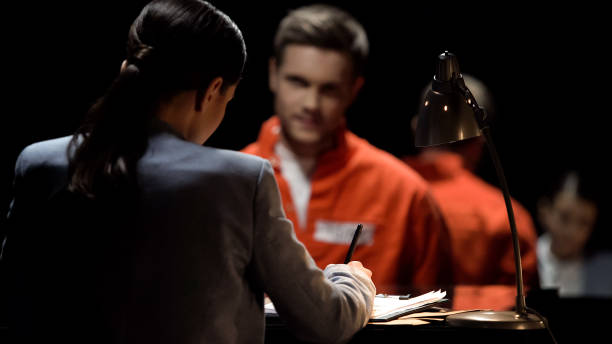 Female defense attorney writing accused prisoners statements for court, advocacy Female defense attorney writing accused prisoners statements for court, advocacy police interview stock pictures, royalty-free photos & images