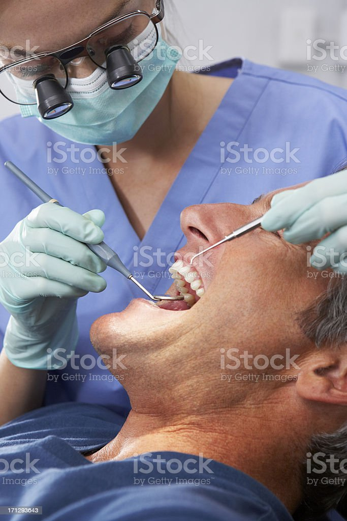 Female Dentist Giving Male Patient Check Up royalty-free stock photo