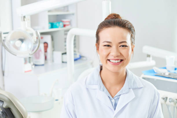 Female Dentist Smiling At Camera stock photo