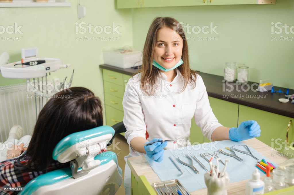 Female dentist working at dental clinic with female patien royalty-free stock photo