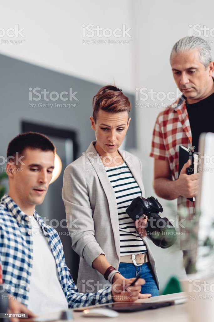 Female Design Manager Having A Meeting With Colleagues Stock Photo Download Image Now Istock