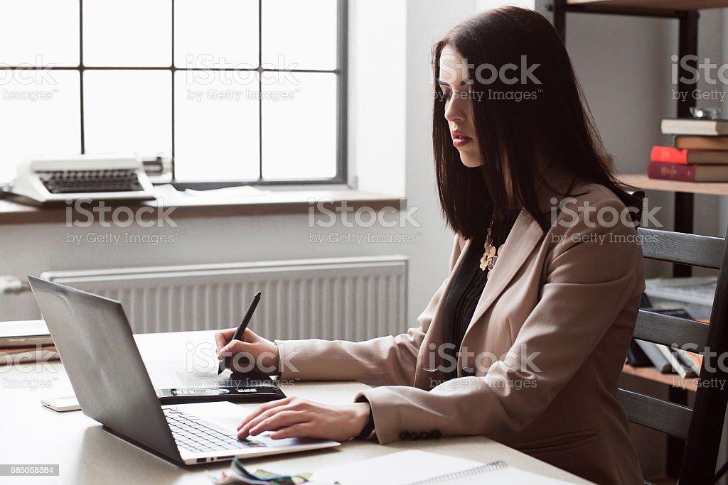 Female designer editing artwork graphic tablet stock photo