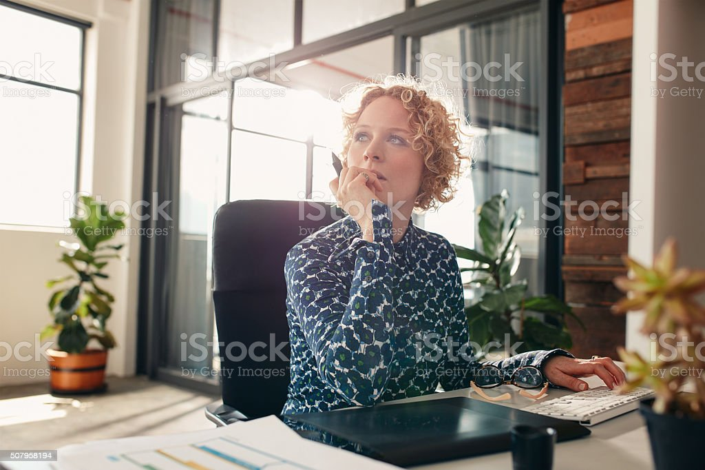 Female designer thinking of new ideas stock photo