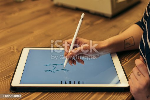 Female designer using graphic tablet and stylus pen