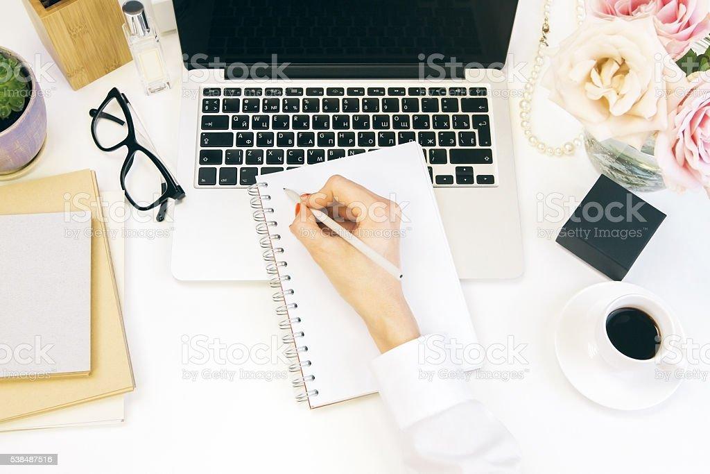 Female desktop writing stock photo