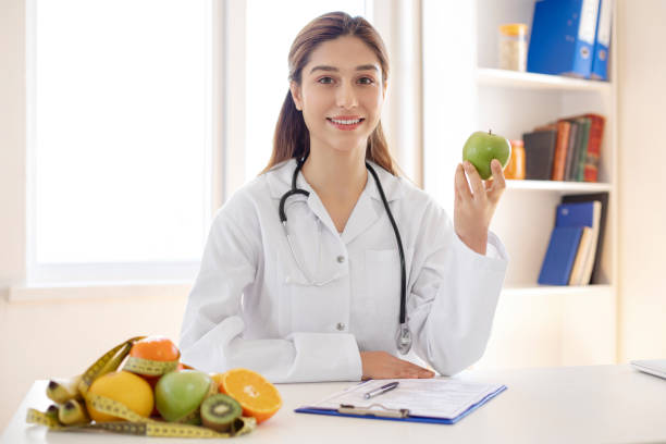 female dietician showing - dietician stock pictures, royalty-free photos & images