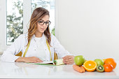 Female dietician with vegetables and fruit