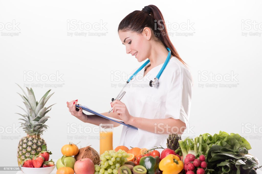 Female dietitian in uniform with stethoscope photo libre de droits