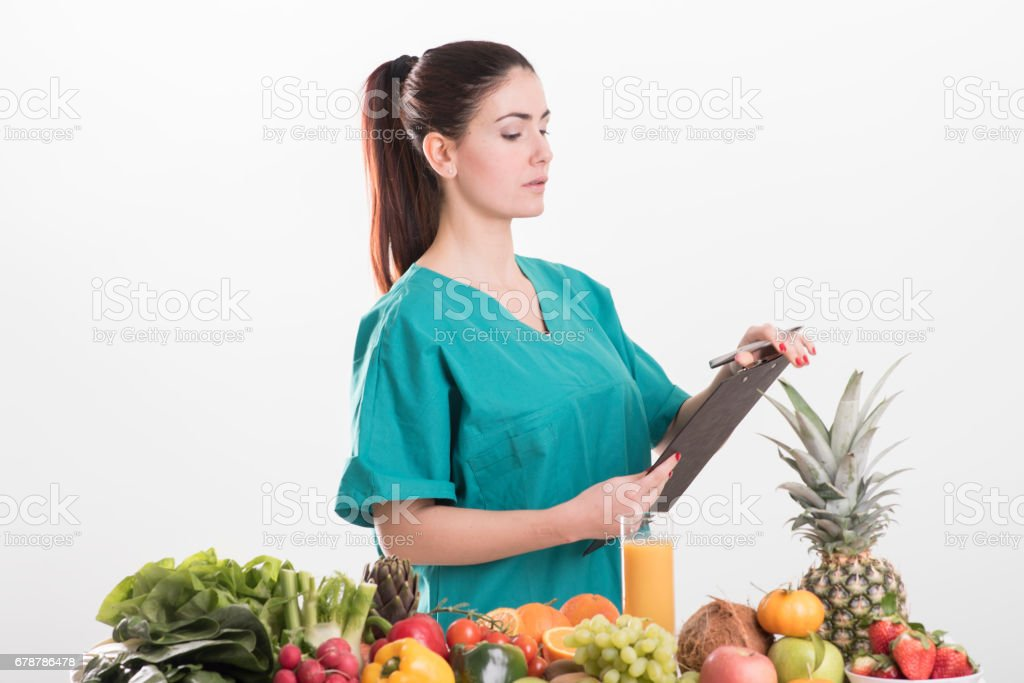 Female dietitian in uniform with stethoscope royalty-free stock photo