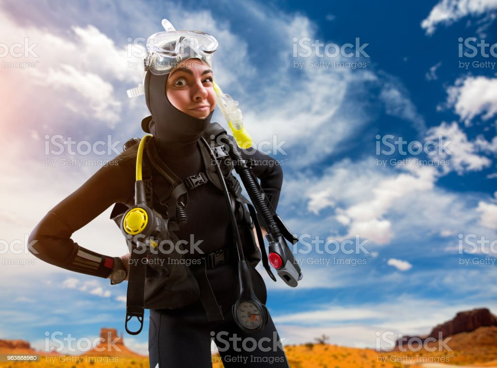 Female diver in diving gear poses on the beach - Royalty-free Adult Stock Photo