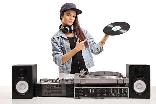 Female DJ holding a vinyl record and pointing
