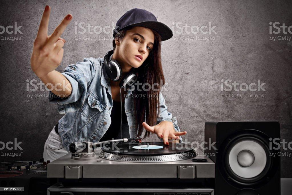 Female DJ making a peace gesture stock photo