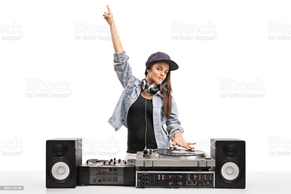 Female DJ playing music on a turntable stock photo