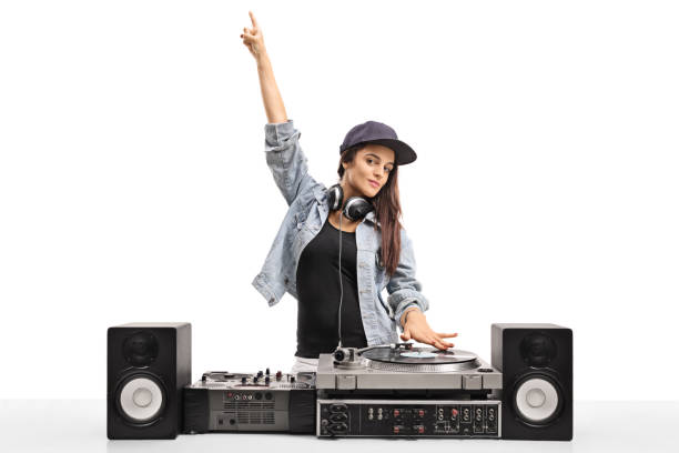 Female DJ playing music on a turntable Female DJ playing music on a turntable isolated on white background dj stock pictures, royalty-free photos & images