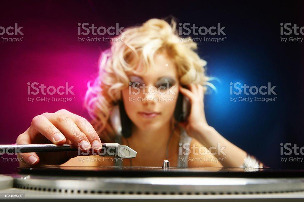 Female DJ playing music royalty-free stock photo