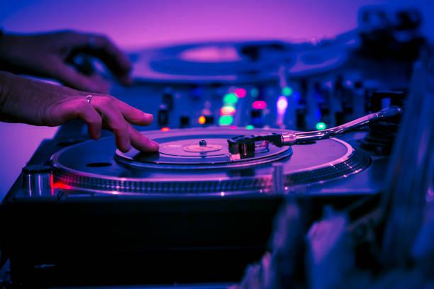 Female DJ playing music vinyl disc