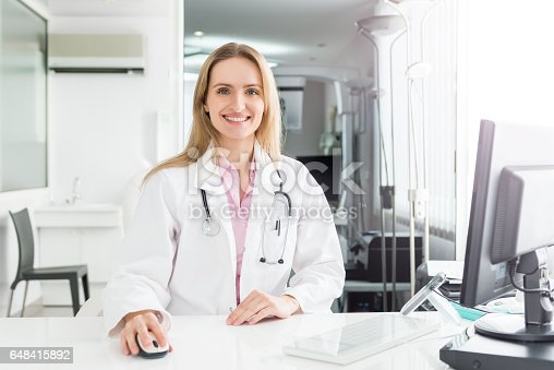 istock Female doctor at clinic 648415892
