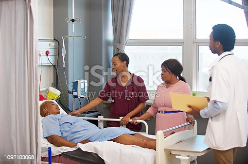 941439642 istock photo Female doctor comforting patient and friend in a hospital 1092103068