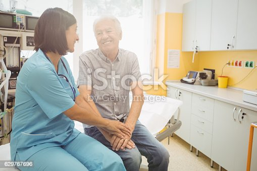 istock Female doctor consoling a patient 629767696