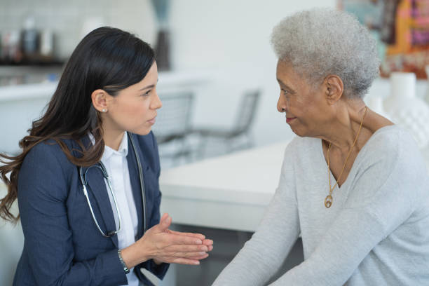 Female Doctor Consulting with a Senior Patient stock photo stock photo