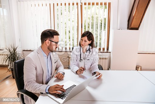 Female doctor discussing with manager.