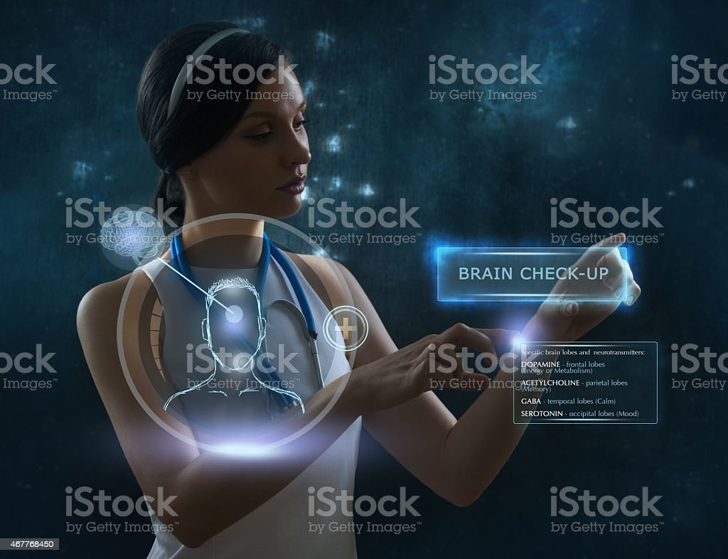 Female doctor doing checkup of human brain using futuristic technology stock photo