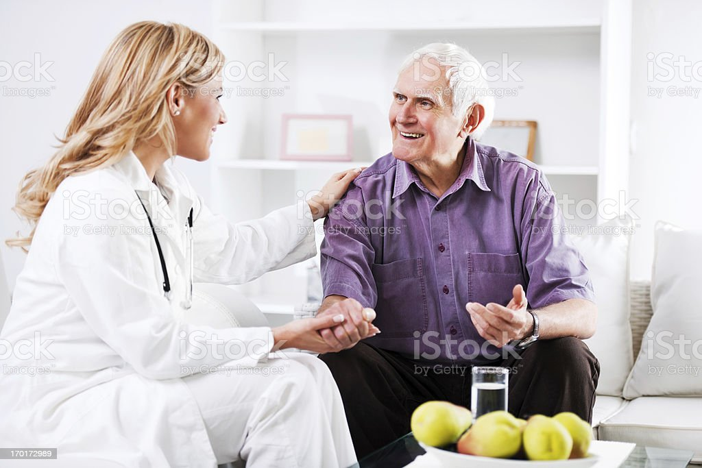 Female doctor examining an elderly patient stock photo