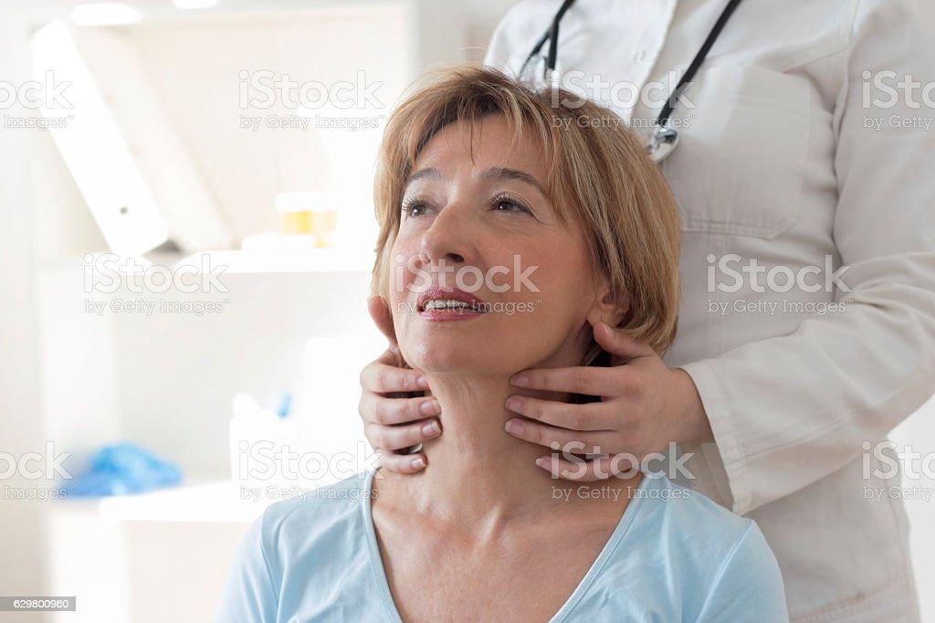 Female doctor examining patient stock photo