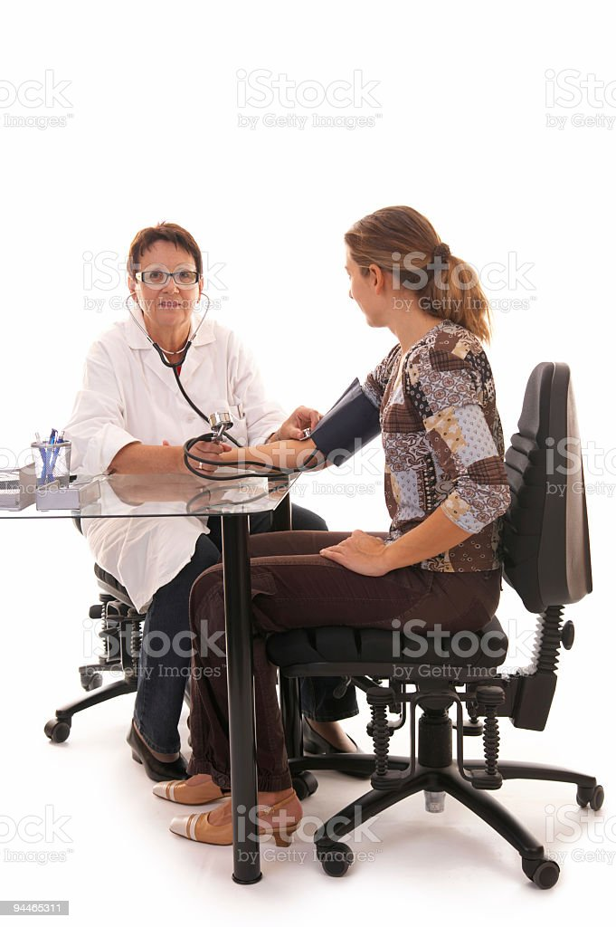 female doctor examining patient royalty-free stock photo