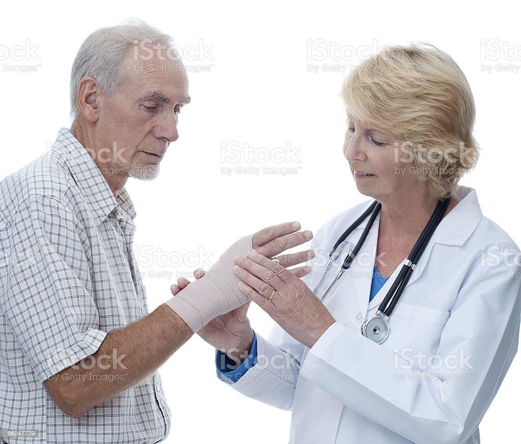 Female doctor examining patient's bandaged hand. royalty-free stock photo