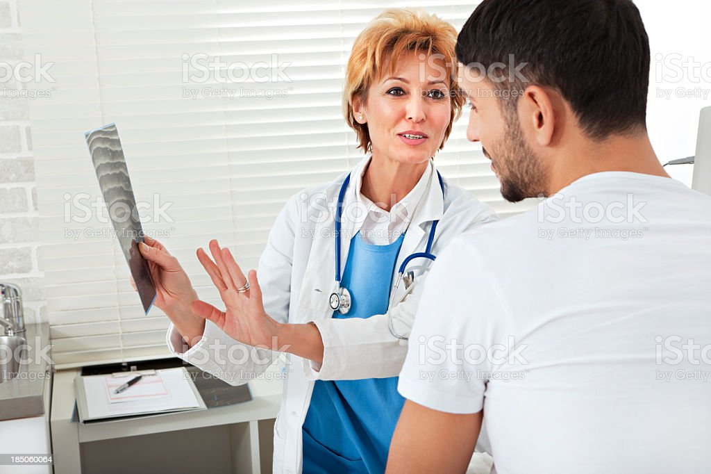 Female doctor explaining an X-ray to a patient stock photo