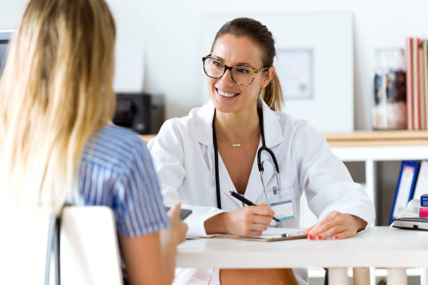 female doctor explaining diagnosis to her patient. - exam stock pictures, royalty-free photos & images