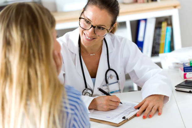female doctor explaining diagnosis to her patient. - medical research stock photos and pictures